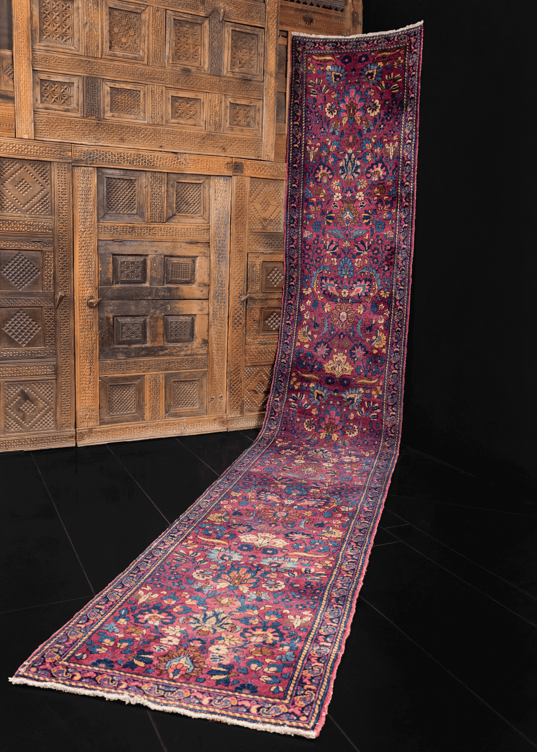 Mashad runner with complex curvilinear floral design on deep purple field