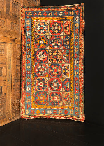 Moghan Kazak rug handwoven during late 19th century in the Caucasus. Vibrant palette that highlight multiple