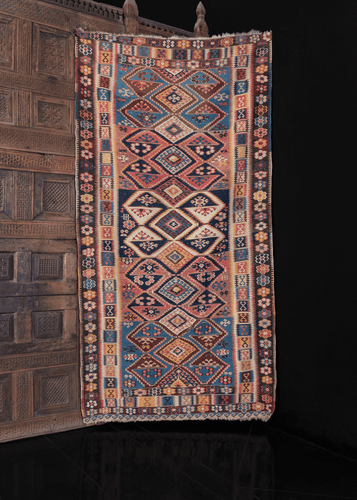 geometric anatolian erzurum kilim from early 20th century with multicolor rainbow geometric design and unusual rosette border