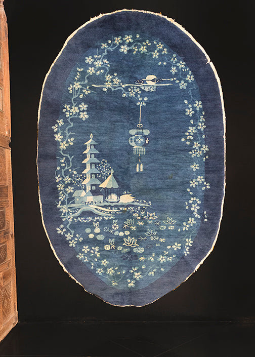 Chinese Peking rug handwoven during first quarter of 20th century. Pictorial scene with pagoda upon a pond of lotus flowers. Night scene with the moon and clouds behind lantern hanging on a cherry blossom branch.