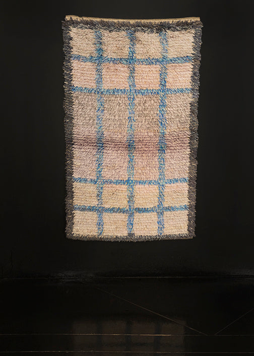 Mid century Rya shag rug handwoven in Sweden. Subtle geometric pattern of a symmetrical grid echoing a window pane. Shades of grey make the field with a grid pattern in light blue.