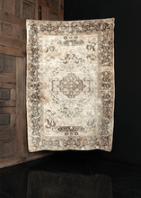 Image of silk Keyseri rug featuring delicate floral pattern on white field with subtle brownish green filigree.