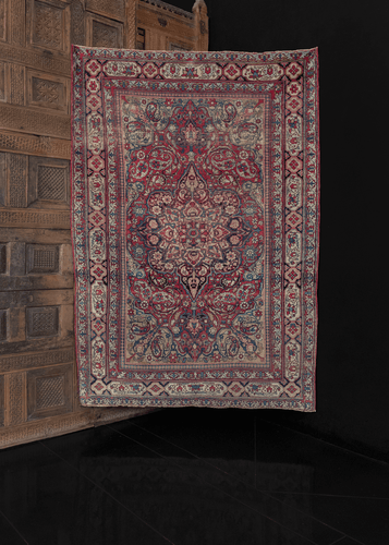 19th century Kerman rug with a central medallion and curvilinear floral design featuring cypress trees and boteh througout. In excellent condition