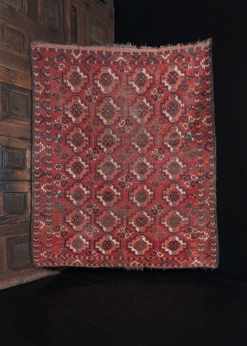 Mid Century Central Asian Ersari Turkmen Rug with repeating gun patterning on a red field