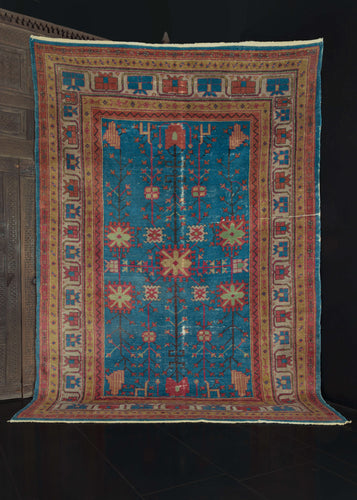 Mid Century bright blue wool NW Chinese Khotan rug
