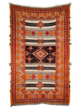 Mid Century Moroccan Ouaouz Area Rug with bright orange and red shaggy pile, as well as neutral toned sumac weave