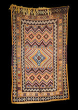 Mid Century Moroccan Ouaouz Area Rug with prominent tumeric color and diamond motifs, excellent patina