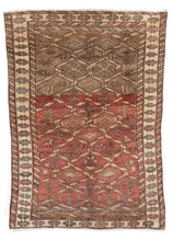 Mid Century NW Persian handwoven wool rug with washed out tones of pale madder red and taupe, featuring a chain link design throughout central design, as well as birds and flowers