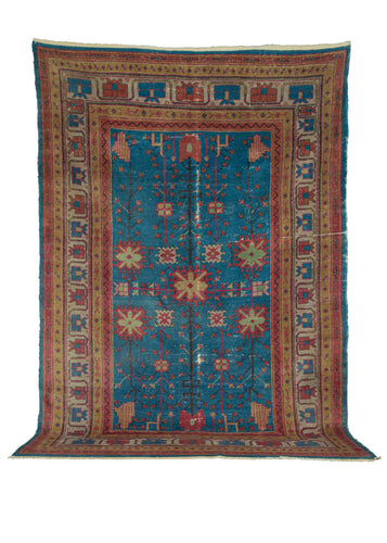Mid Century NW Chinese Khotan rug with bright blue field