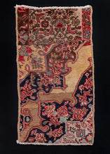 Bidjar wagireh, or rug sample, handwoven in NW Iran during the second quarter of the 20th century. This particular one shows the borders are the top and the repeat unit of the pattern below, showing a floral design for all elements. The colors are in within the typical Bidjar shades of camels, inidigo blues, and madder pinks and reds.   In excellent condition, signs of wear consistent with age. Densely woven with a low pile and sturdy handle.