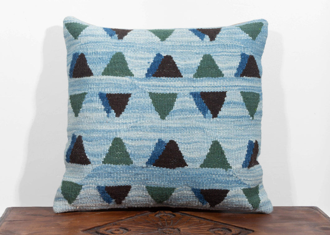 Christian Rathbone Handwoven Wool Naturally Dyed square pillow with indigo blue field and modern triangle design in green and dark brown