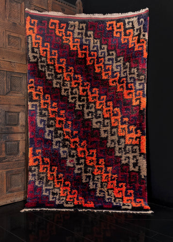 Central Anatolian Yatak rug, handwoven during the third quarter of the 20th century.  It features a diagonal hooked design in bright orange, black, taupe, and wine-red.   In excellent condition, signs of wear consistent with age. High pile with a dense fluffy quality.