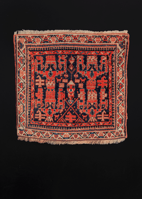 Northwest rug handwoven in NW Iran during the second quarter of the 20th century.  This quirky rug features a very unique and unusual geometric design in bright oranges and reds on a deep indigo field. The ivory border frames the design, giving the rug a very painterly quality. Would look fantastic as a wall hanging!  In very good condition, signs of wear consistent with age.