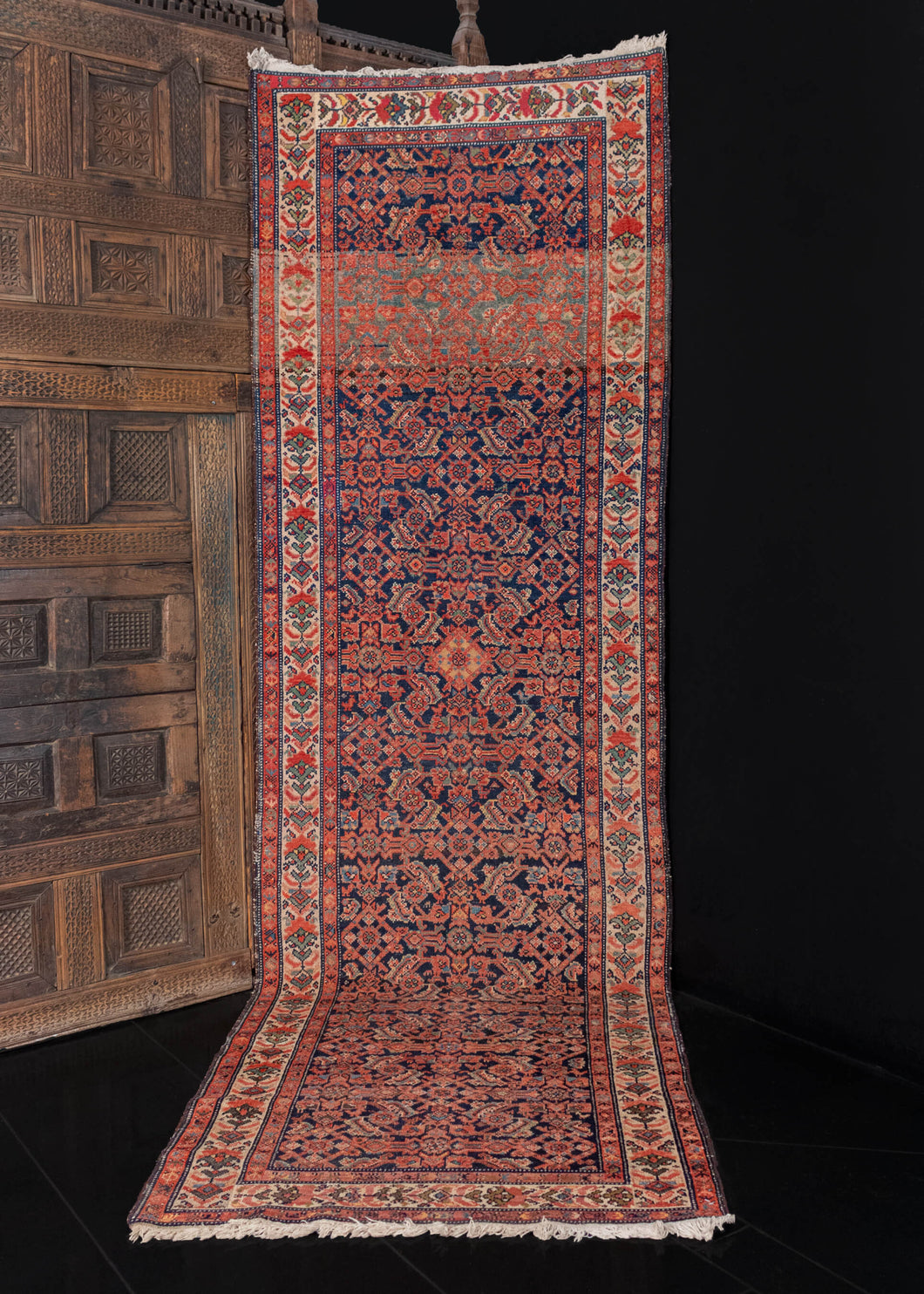 Mid century Malayer runner handwoven in NW Iran.   This classic rug features an allover Herati design on a deep indigo blue field. Other colors in the design are bright madder reds, light and dark browns, and soft beiges and ivories. The border is composed of a funky and unusual flower design.    In perfect condition, signs of wear consistent with age. Tightly woven low pile, with a heft handle.