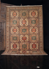 Turkish Sivas rug handwoven during the third quarter of the 20th century.   This rug features an allover medallion design, with an earth toned color palette composed of reds, greens, and a variety of browns.  In perfect condition, signs of wear consistent with age. Low pile, with a dense handle.