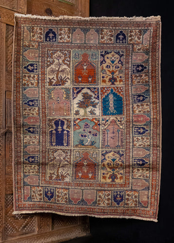 Turkish Kayseri rug handwoven during the second quarter of the 20th century.   This elegant little rug features a sophisticated garden block design on a taupe field, which is also repeated in the main border. Each block has a unique design that is repeated once within the field design, and consist of various garden motifs. In excellent condition, signs of wear consistent with age. Low pile and densely woven, extremely soft and shiny.
