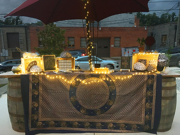 Our booth at the Moonlit Market at Burial Beer co showing off our handmade hats and books