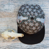 Red fox skull patterned flat bill six panel hat featuring full size prints of the skull on each side