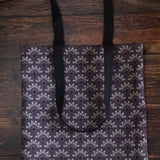 Purple tote bag with bone fans pattern made from durable Eco Canvas