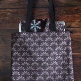 "Purple tote bag with bone fans pattern made from durable Eco Canvas easily carries a 15"" laptop"