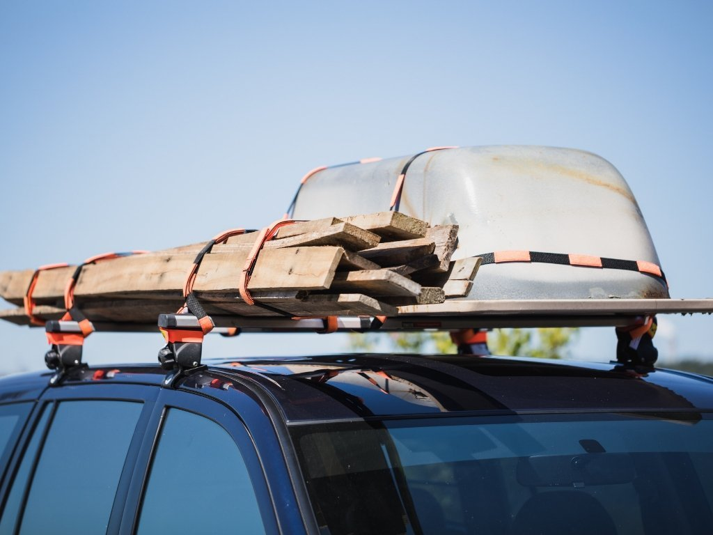 How to Tie Luggage Down with Roof Rack Straps | WRAPTIE