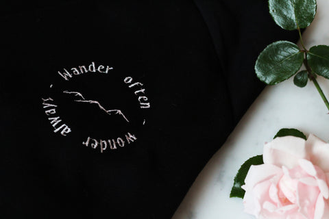 Organic cotton embroidered jumper with inspirational slogan