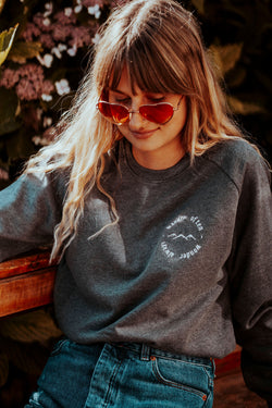 Wanderlust slogan embroidered organic cotton ethical jumper by MOR wares