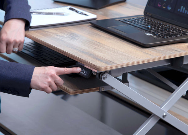 Attollo Desk is an Electric Raising Desk that lifts and lowers with the push of the button to go from sitting to standing