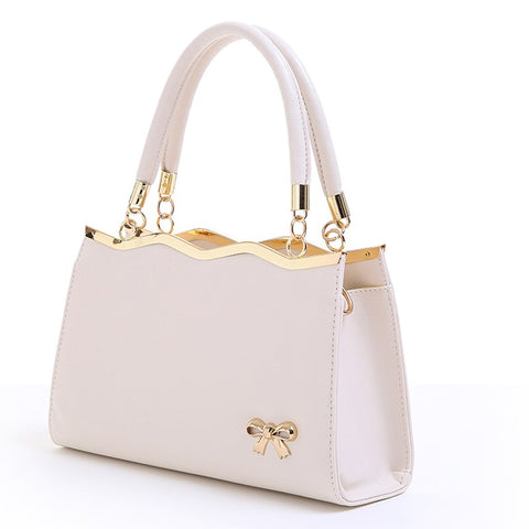 white handbag with gold trimming