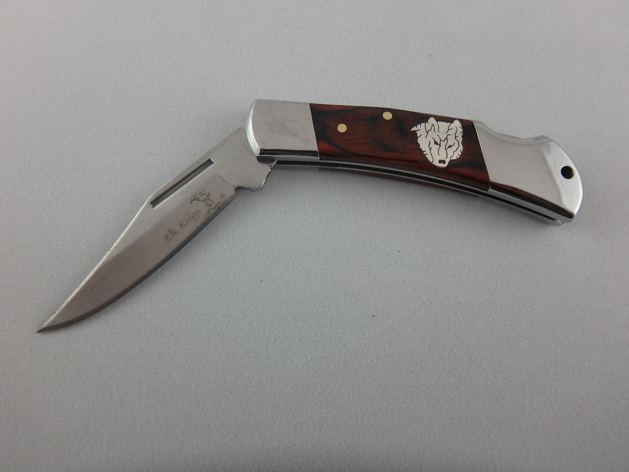 "Custom Silver inlay Wolf folding pocket knife 3"" folded length."