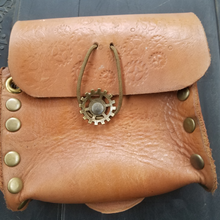 Leather pouch with gears and brass