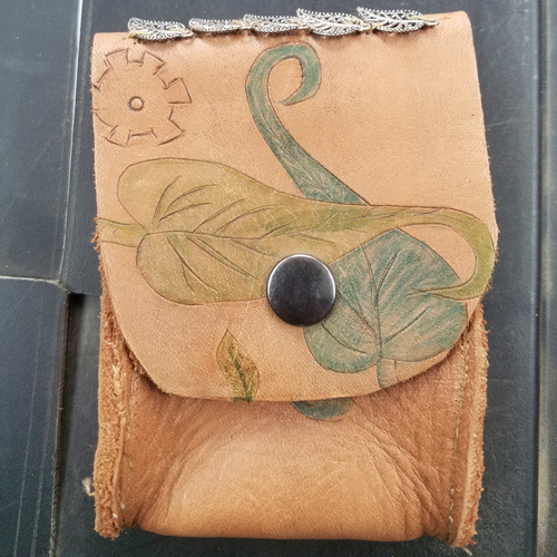 leaf tooled leather pouch