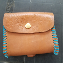 Leather pouch gear accents blue lacing