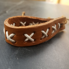 tan bracelet white lacing