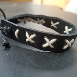 black bracelet white lacing