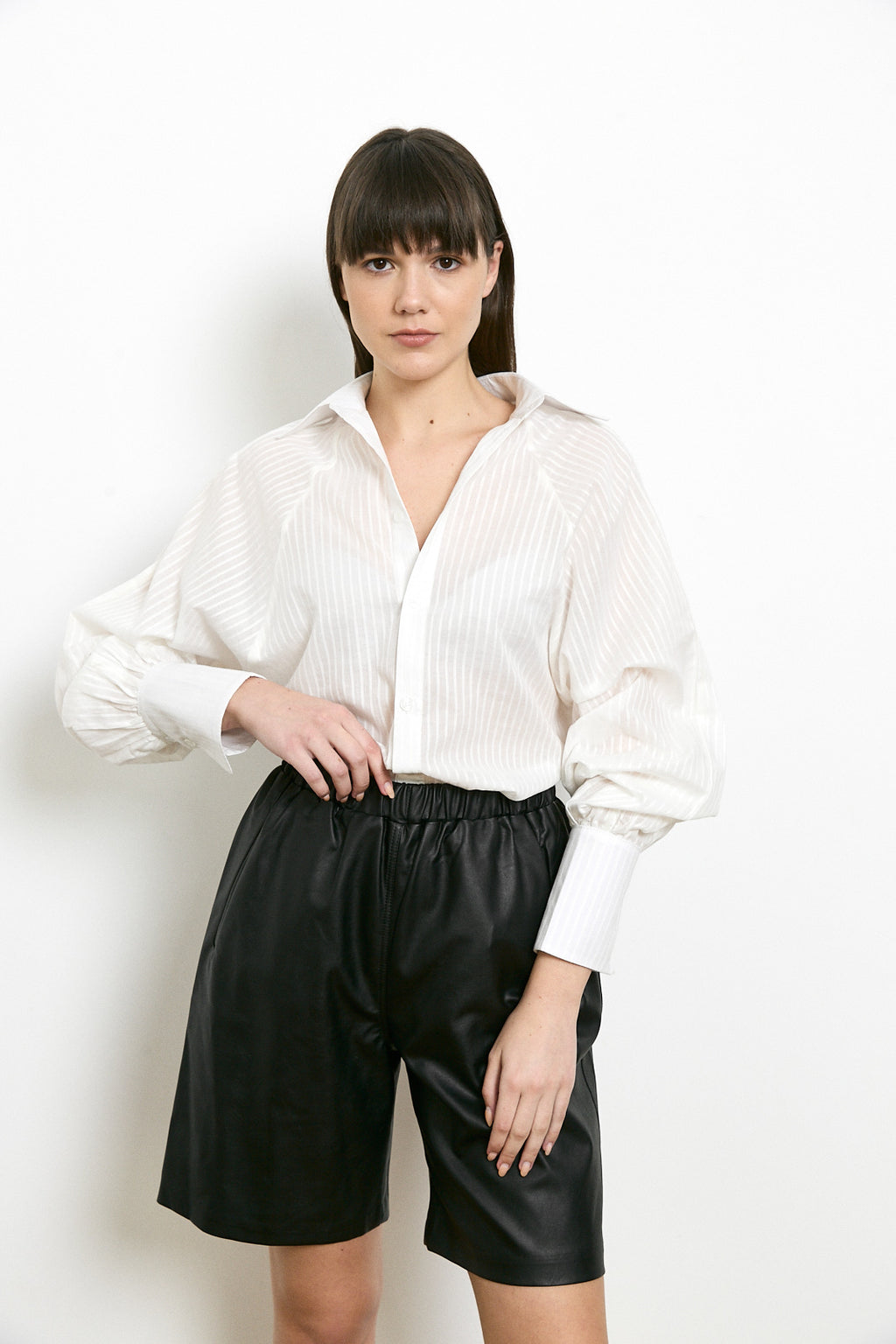 RUFFLED BACK BUTTONED BLOUSE