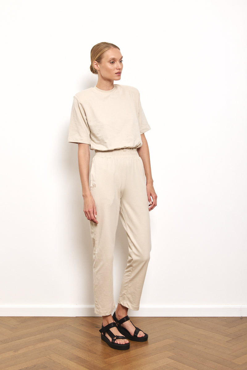 Padded shoulder jumpsuit in Stone