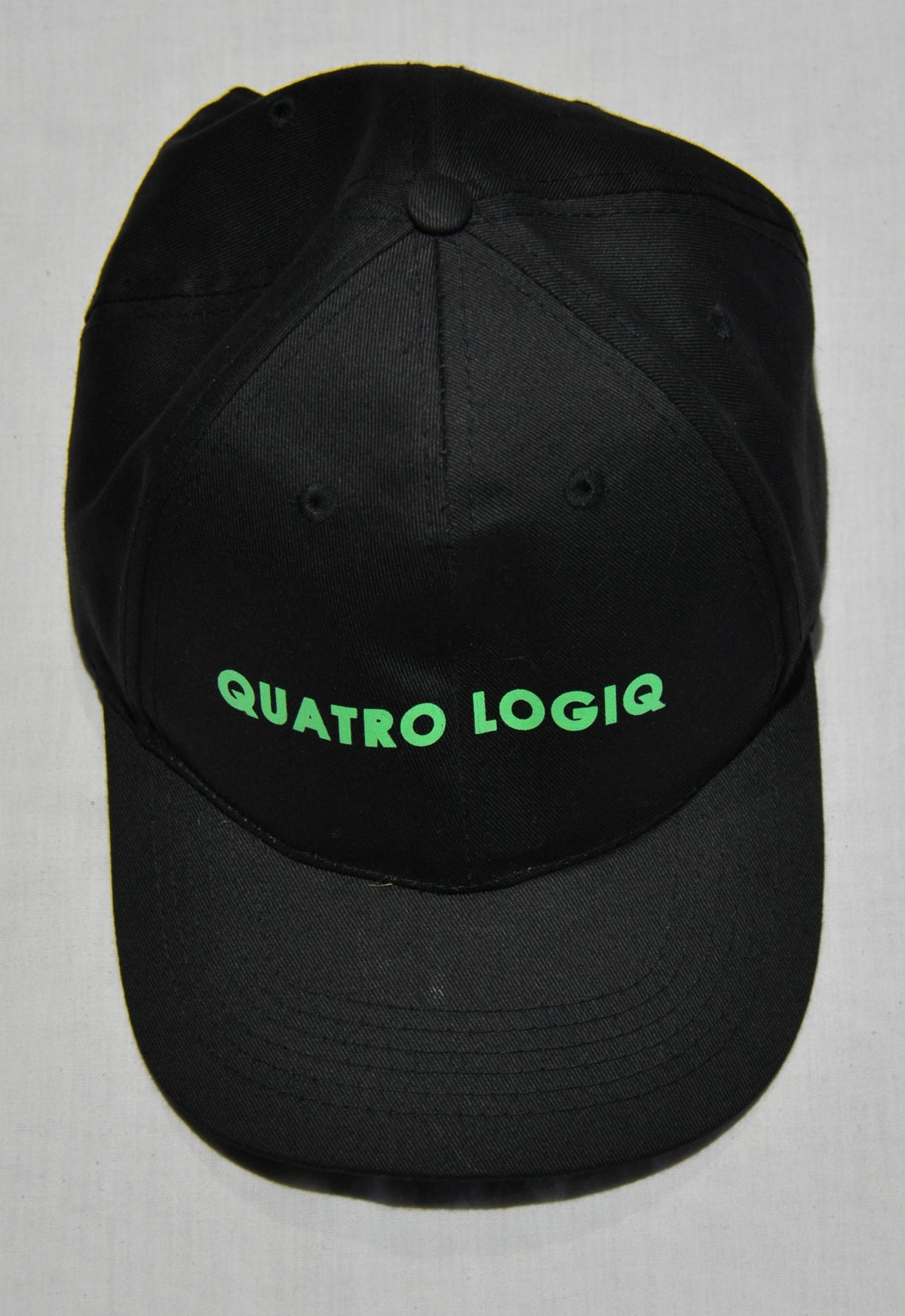 Black Quatro Logiq adjustable baseball cap made from quality material and super comfortable.