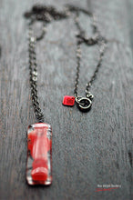 "Red ghost glass pendant with gun metal black chain 30"" & signature tag"