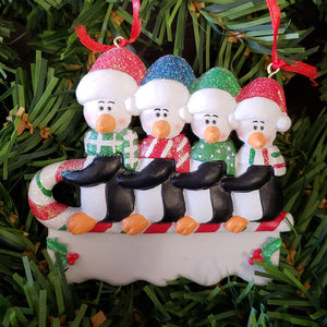 Penguins on Sled Family Ornament