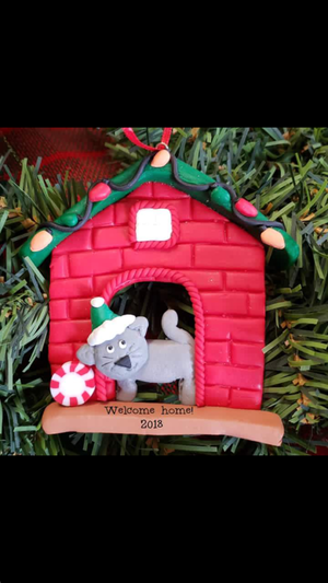 Cat by fireplace ornament