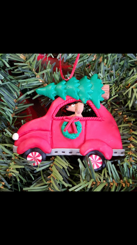 Dog driving car with tree on top Ornament
