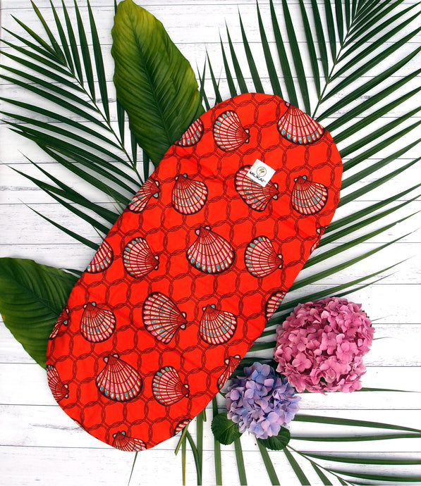 MILIKAI CO 100% cotton bassinet liner handmade from traditional African ankara fabric. Red sea shell variant. Three layers of inner cotton wadding for extra comfort. Made to complement the MILIKAI CO Pilot stroller. Length 70.5 centimetres, width 32 centimetres.