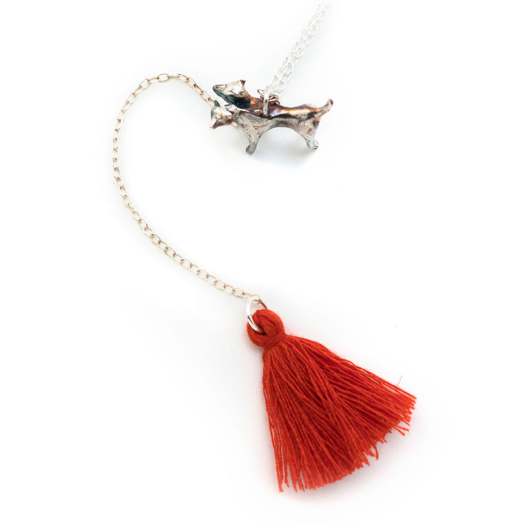 Two-headed hound necklace + red tassel