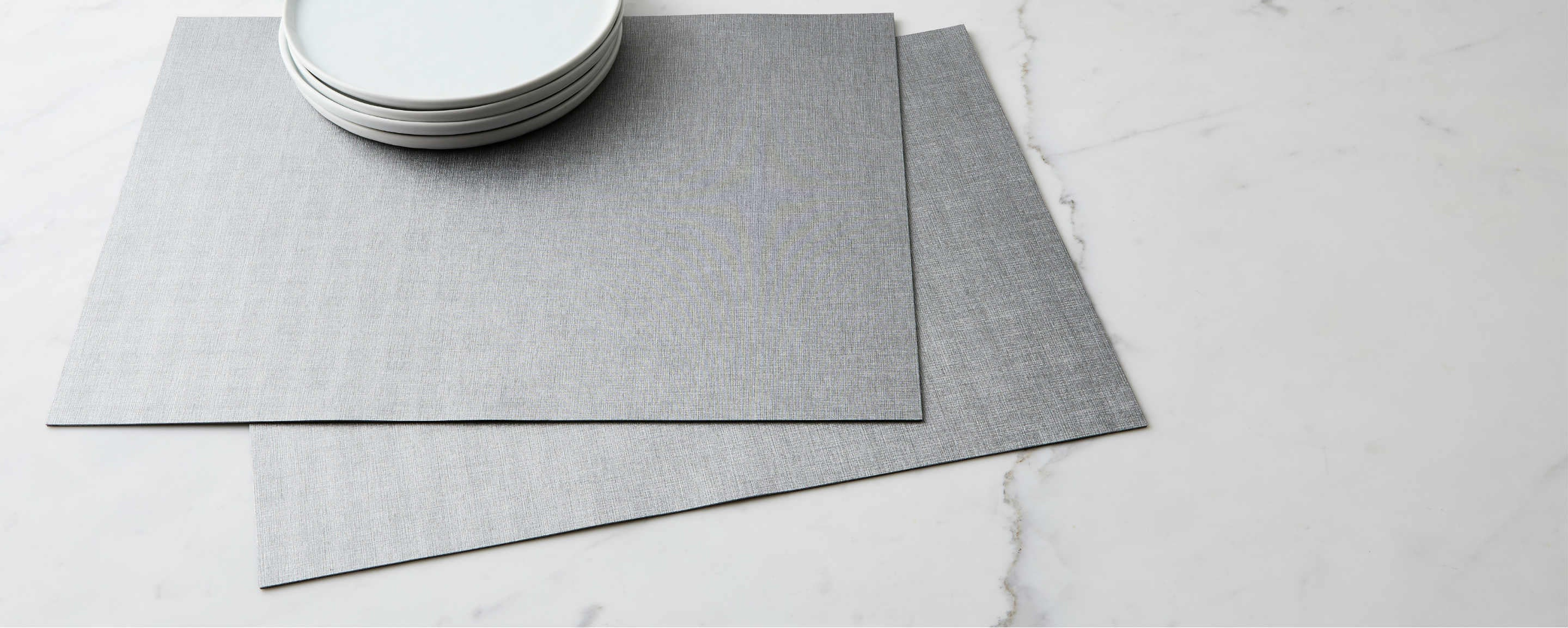 textured silver placemat