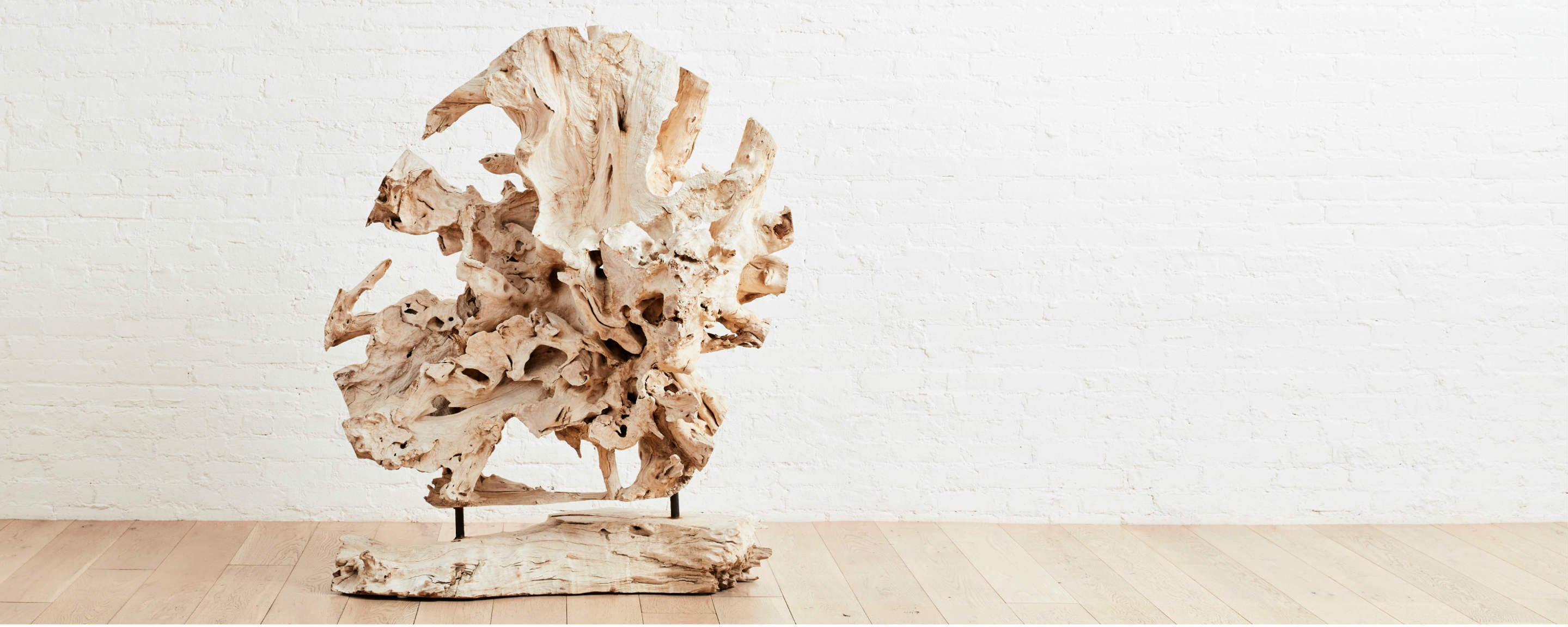 bleached teak sculpture on wood stand
