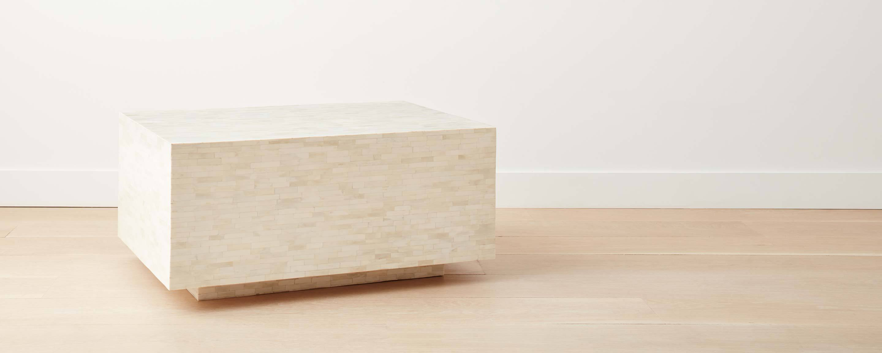 bone coffee table with pedestal base