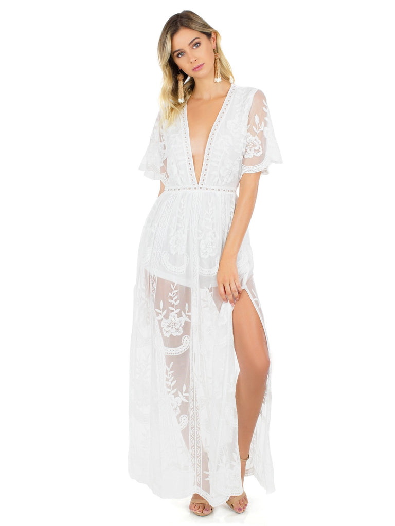 Women wearing a romper rental from FashionPass called Kennedy Maxi Dress