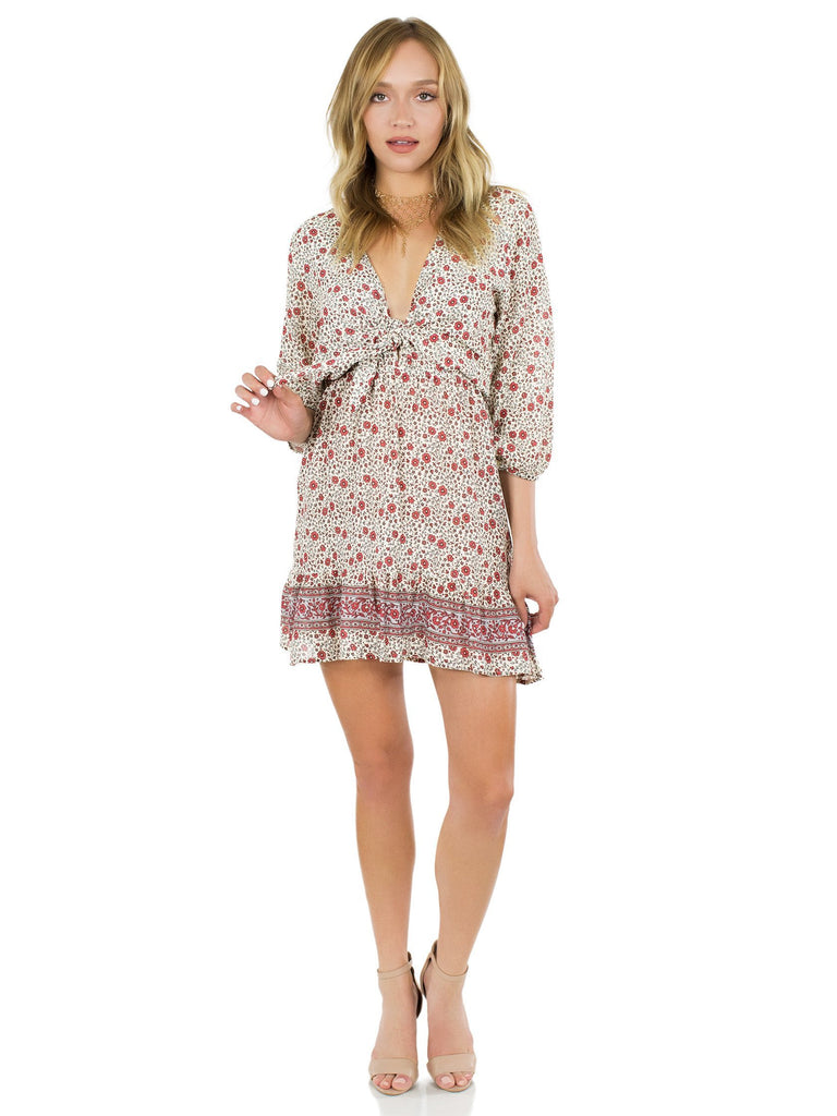 Woman wearing a dress rental from roe + may called Aiden Print Mini Dress