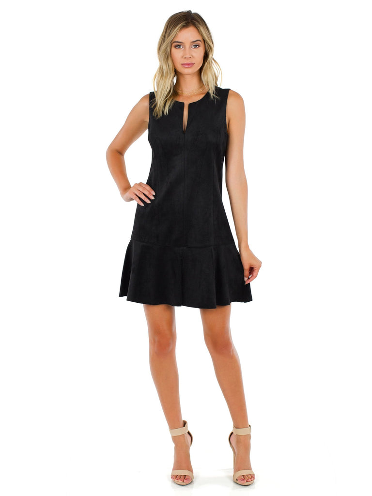 Woman wearing a dress rental from BCBGMAXAZRIA called Black Drive Me Home Mini Dress